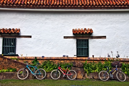 Three Bicycles Resting on a Wall Stock Photo - 12943544