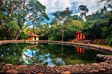 A natural swimming pool and colonial style buildings in Villa de Leyva, Colombia