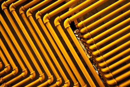 An image of yellow pipes forming an interesting pattern  photo