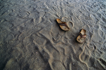 Flip flops in the sand at a beach  photo
