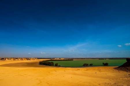 A bay with green water and a deep blue sky in Guajira, Colombia  Stock Photo