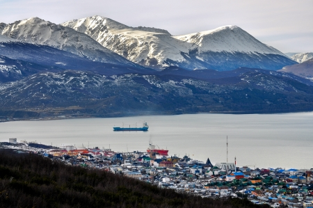 tierra: A view of Ushuaia with snowy mountains behind it  Stock Photo