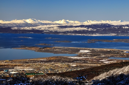 southernmost: Ushuaia with the Beagle Channel and snow covered mountains behind it