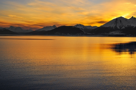 Watching the sunset over the mountains from the Beagle Channel in Tierra del Fuego, Argentina  Stock Photo - 15281185