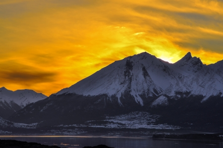 southernmost: An orange sky at sunset behind a mountain in Tierra del Fuego