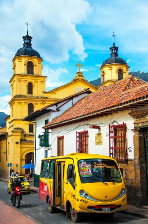 A bus and other traffic in the historic Candelaria neighborhood of Bogota, Colombia