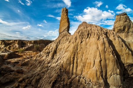 huila: A stone pillar in a desolate wasteland