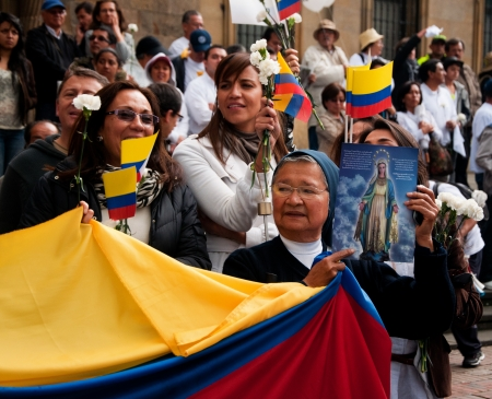 dissent: Bogota, Colombia - DECEMBER 6: People lining the streets to protest against the FARC