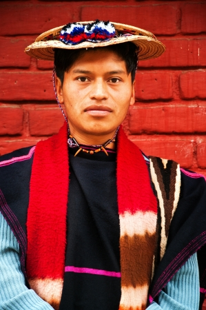 indigenous: Silvia, Colombia - APRIL 6: Portrait of a traditionally dressed young indigenous man.