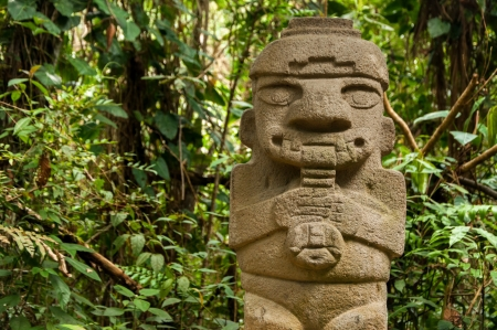 An ancient, flute playing, pre-columbian statue in San Agustin, Colombia Stock Photo