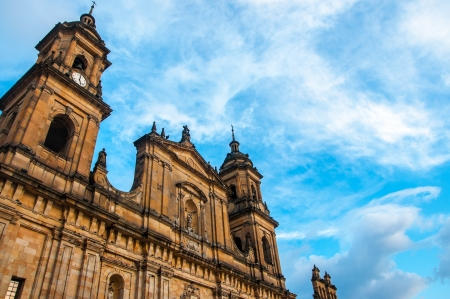 The front of the cathedral in Bogota, Colombia with a blue sky behind it
