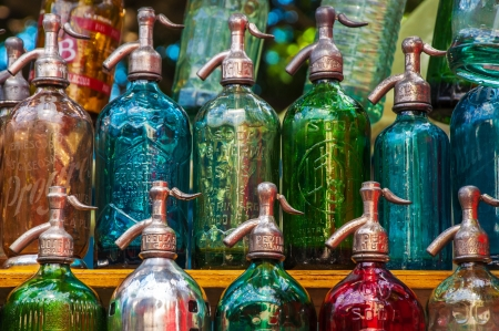 seltzer: Colorful antique soda bottles in a market in Buenos Aires Stock Photo