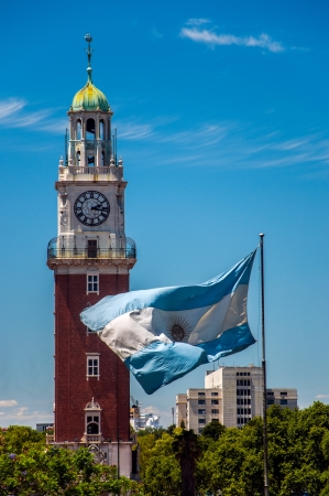 aires: The Torre Monumental and Argentine flag Stock Photo