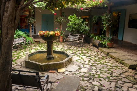Beautiful old fountain in a colonial courtyard in Villa de Leyva, Colombia