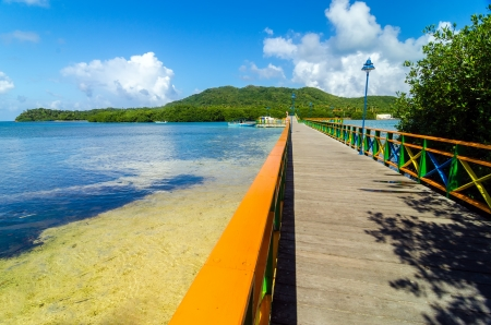 View of colorful bridge connecting two tropical islands photo