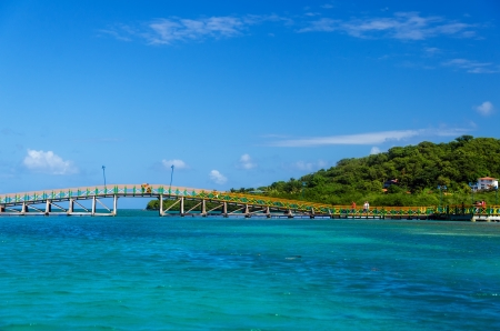 Colorful bridge connecting two lush tropical islands in San Andres y Providencia, Colombia