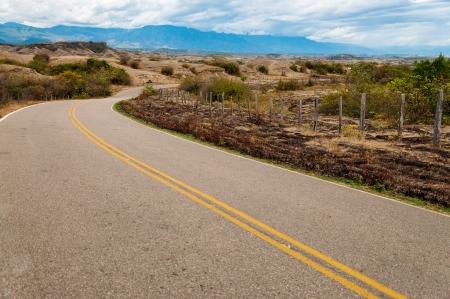 huila: Long winding road through a dry arid landscape