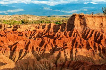 Red hills of Tatacoa Desert bathed in sunlight in Huila, Colombia photo