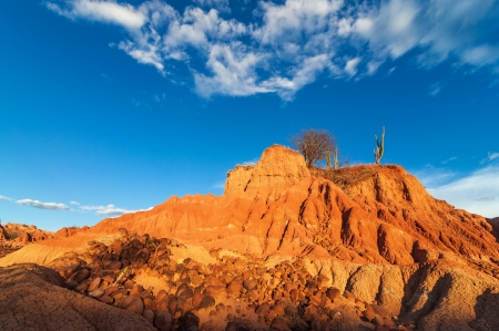 huila: Red hill in a desert with large rocks scattered around the base in Huila, Colombia Stock Photo