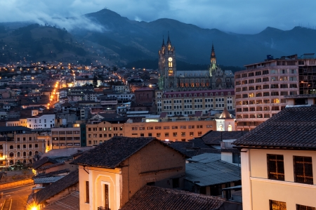 Night view of the historical center of Quito, Ecuador with the basilica in the background photo
