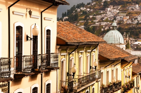 Row of historic colonial buildings in Quito, Ecuador photo