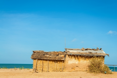 mud house: A mud house, typical housing of Wayuu Indians in La Guajira, Colombia on a beach Stock Photo