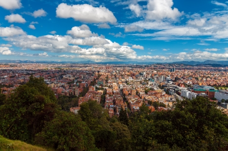 View of Bogota, Colombia under a beautiful deep blue sky photo