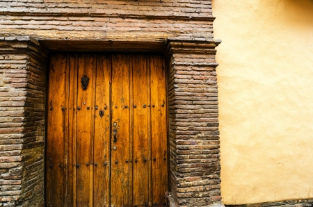 Old colonial wall and door in La Candelaria in Bogota, Colombia photo
