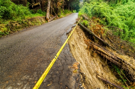 washed out: A rural road that has been washed out and is heavily damaged