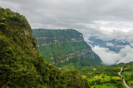valley below: Dramatic view of forest covered cliffs with a valley far below