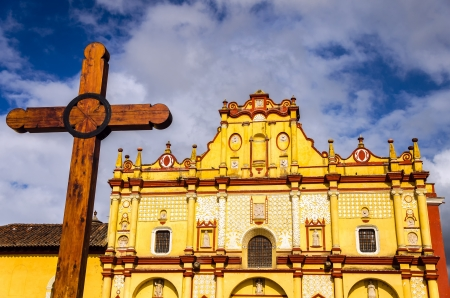 The colorful cathedral and cross in San Cristobal de las Casas in Chiapas, Mexico