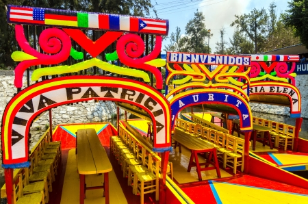 The clorful boats on ancient Aztec canals at Xochimilco in Mexico City Editorial
