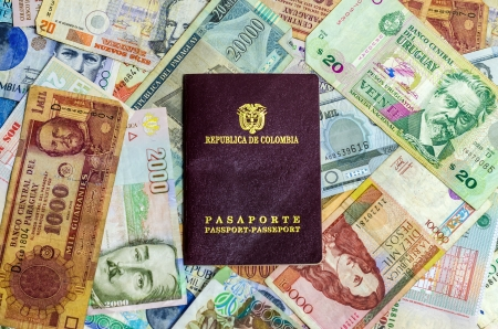 colombian: Colombian passport with various Latin American currencies Stock Photo