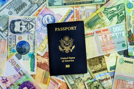 us paper currency: American passport with various Latin American currencies