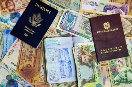 colombian: Three passports with various currencies from Latin America Stock Photo