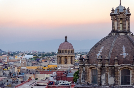 Church domes and cityscape in Mexico City