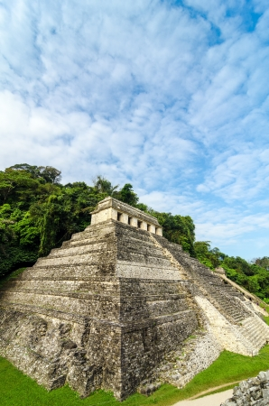 mesoamerica: Vertical view of the Temple of Inscriptions at Palenque with a beautiful sky Stock Photo