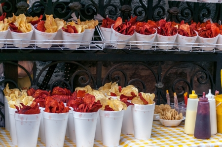 street vendor: Red and yellow potato chips being sold from a stall in Mexico City Stock Photo
