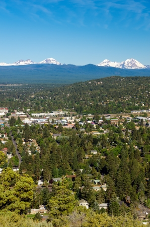 cascade range: A vertical shot of the city of Bend with the Three Sisters of the Cascade Range Stock Photo