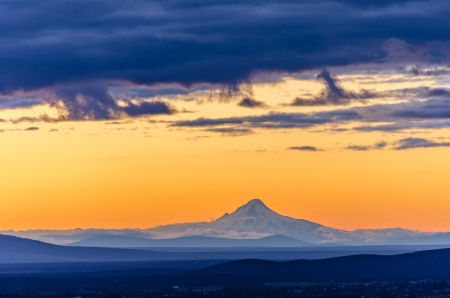 oregon cascades: Orange sky over Mt  Hood seen during sunset from Bend, Oregon