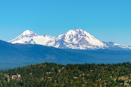 oregon cascades: View of the snow covered Three Sisters mountains in the Cascade Range