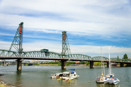 hawthorne: Hawthorne Bridge in Portland, Oregon and view of the Willamette River with several boats in the foreground