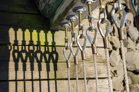 Abstract view of a fence casting deep shadows photo
