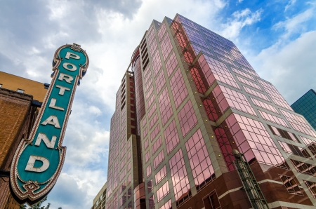 Iconic Portland sign with pink skyscraper rising next to it Editorial