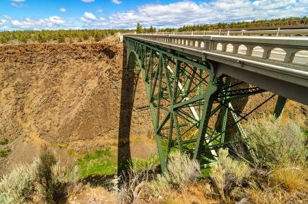 Old abandoned highway bridge crossing the Crooked River canyon photo