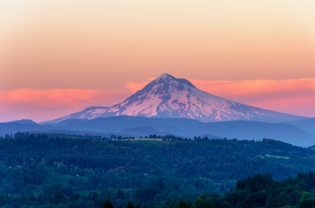 Mount Hood looking purple as the sun sets in the Pacific Northwest