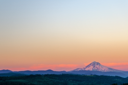 mt  hood national forest: Mount Hood looking purple at sunset with sky taking up most of the frame