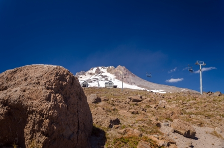 View of the summit of Mount Hood with a boulder in the foreground photo