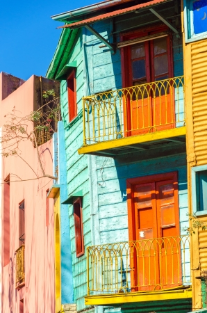 Brightly colored balconies on a dilapidated building in La Boca neighborhood of Buenos Aires photo