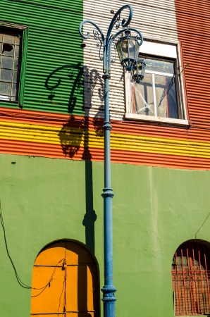 la boca: Streetlight set against a colorful wall in La Boca neighborhood of Buenos Aires, Argentina